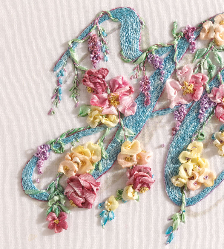 Fly stitch leaves with dark pink roses